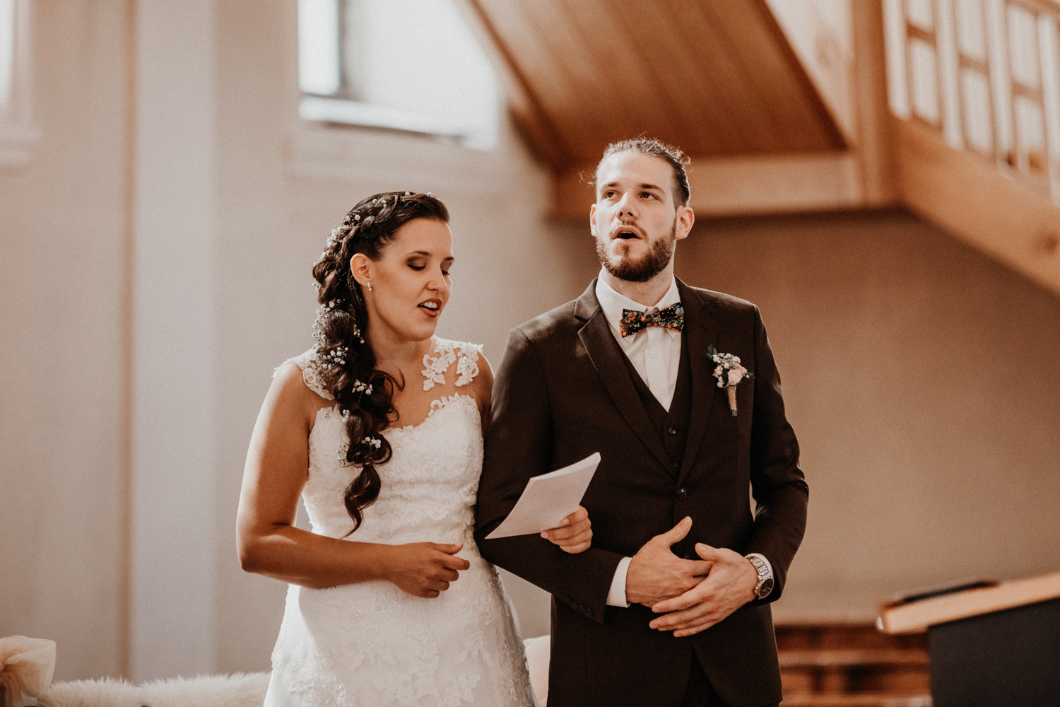 wedding photographer switzerland bride groom church wedding singing