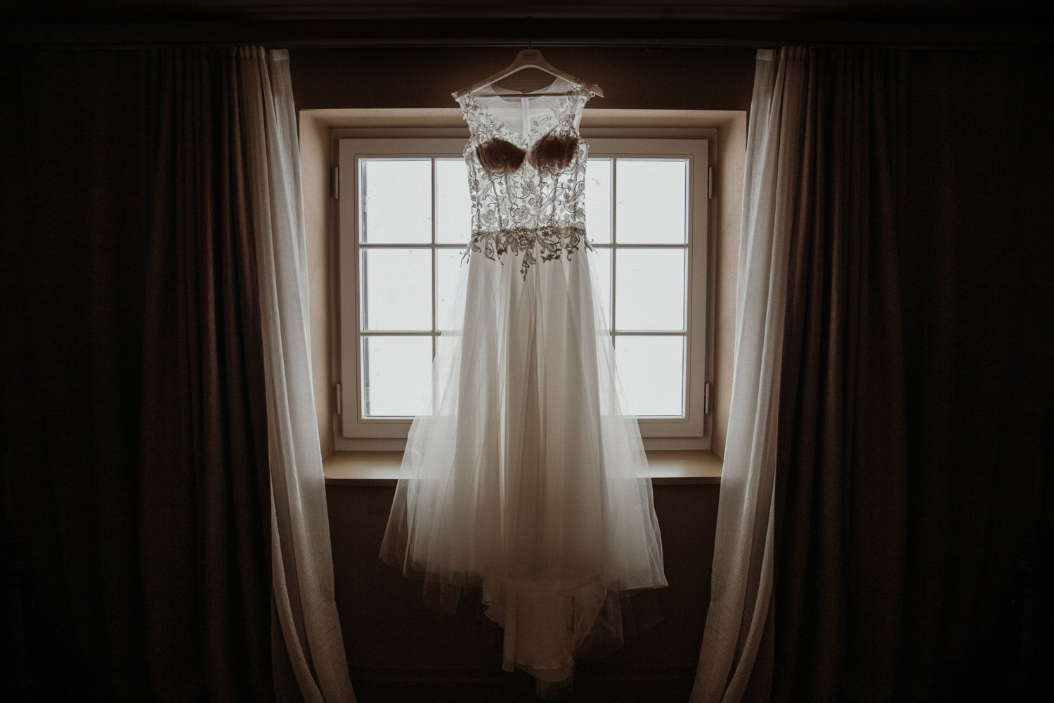 wedding photographer in St. Ursus Cathedral Solothurn Switzerland documentary style Swiss wedding photographer getting ready La Couronne wedding dress