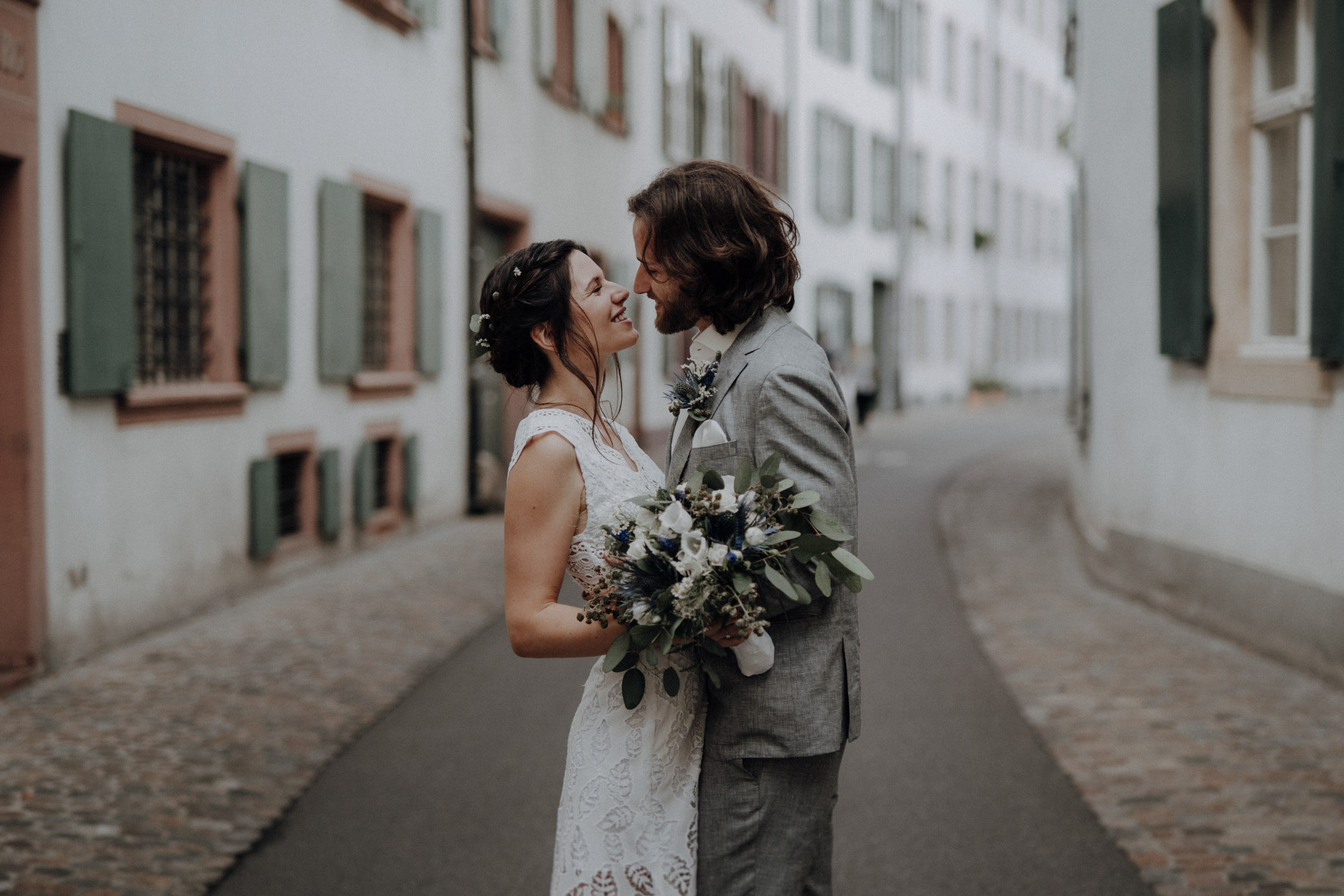 Wedding photographer switzerland basel natural unposed civil wedding old town Basel Minster couple shoot