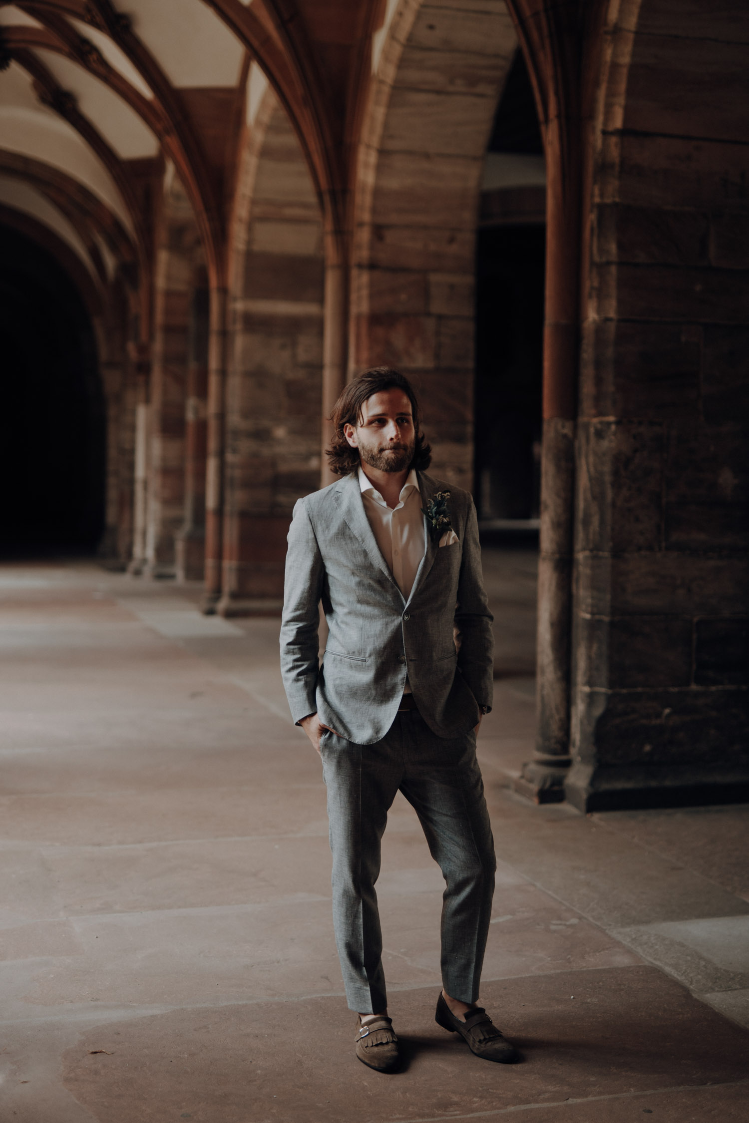 Wedding photographer switzerland basel natural unposed civil wedding old town Basel Minster couple shoot bohemian style groom waiting first look