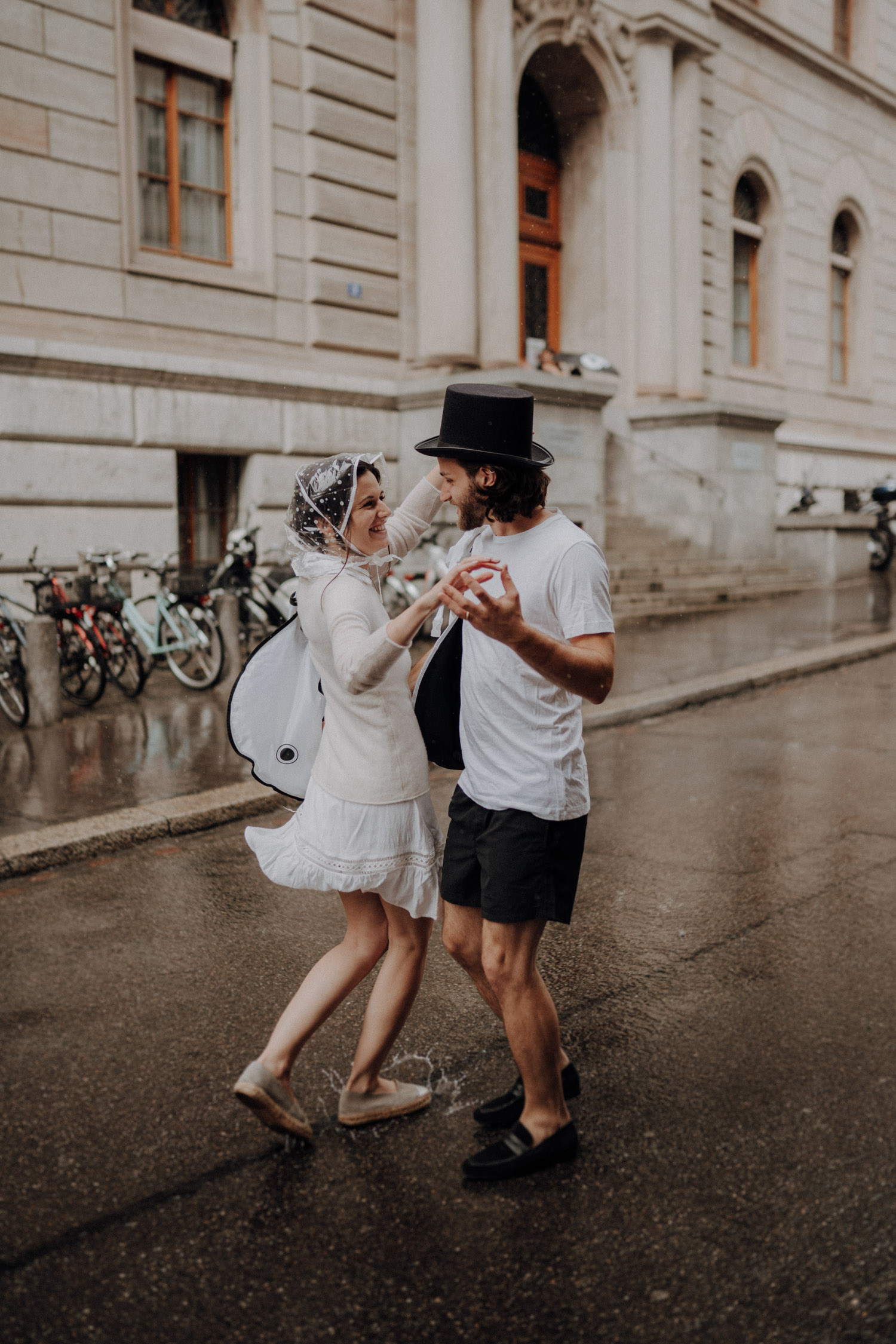 Wedding photographer switzerland basel natural unposed civil wedding old town Basel Minster couple shoot bohemian style documentary rainy wedding dancing in the rain