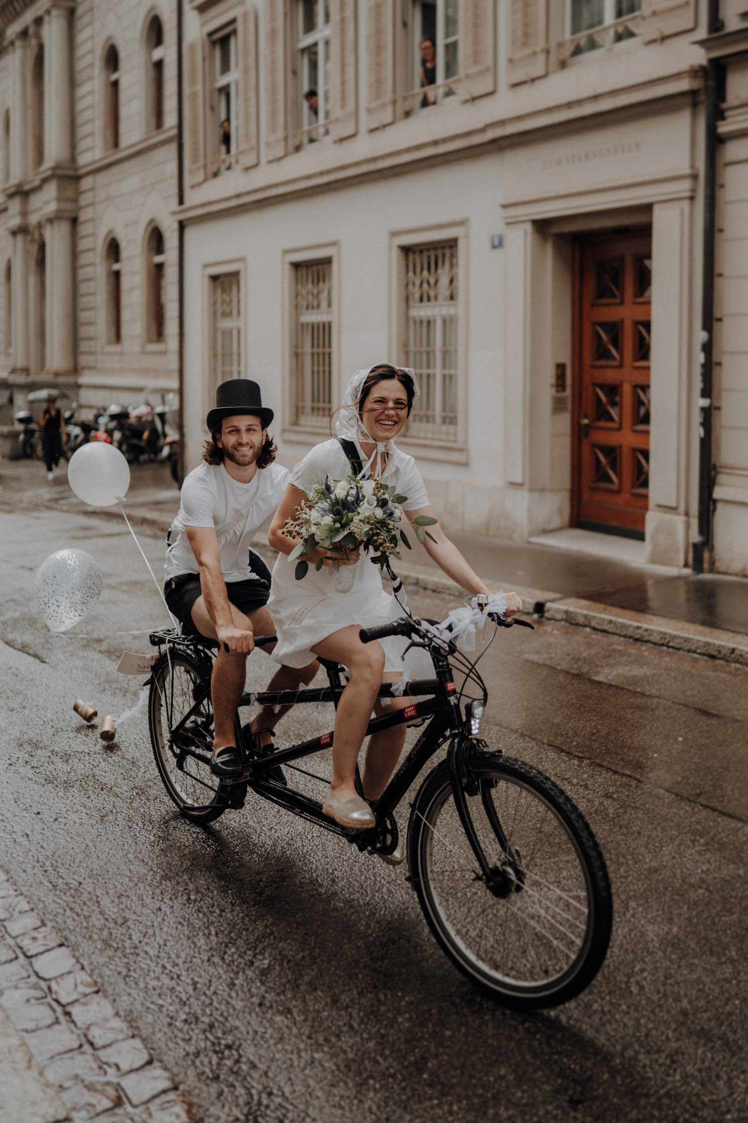 Wedding photographer switzerland basel natural unposed civil wedding old town Basel Minster couple shoot bohemian style documentary rainy wedding tandem