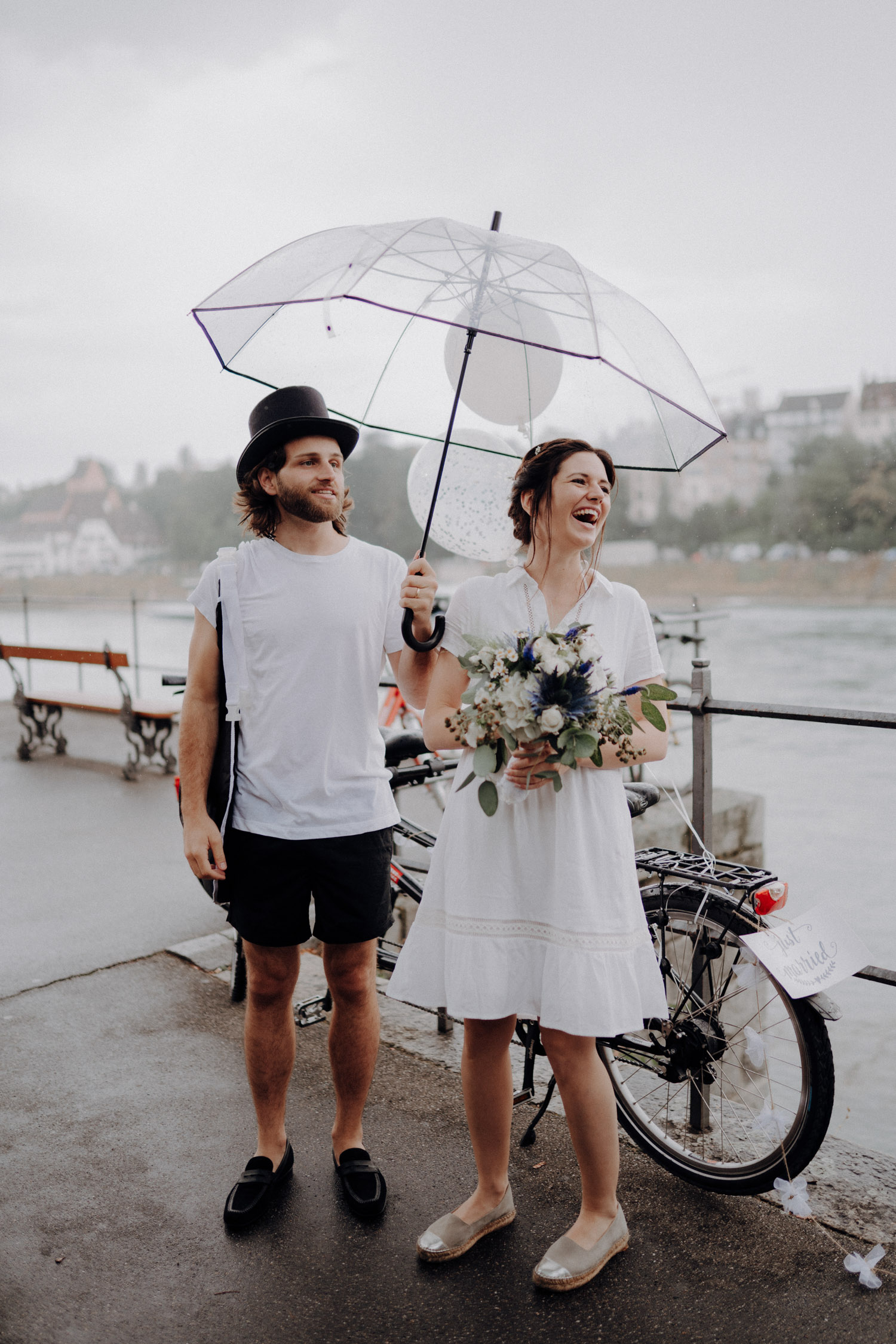 Wedding photographer switzerland basel natural unposed civil wedding old town Basel Minster couple shoot bohemian style documentary rainy wedding